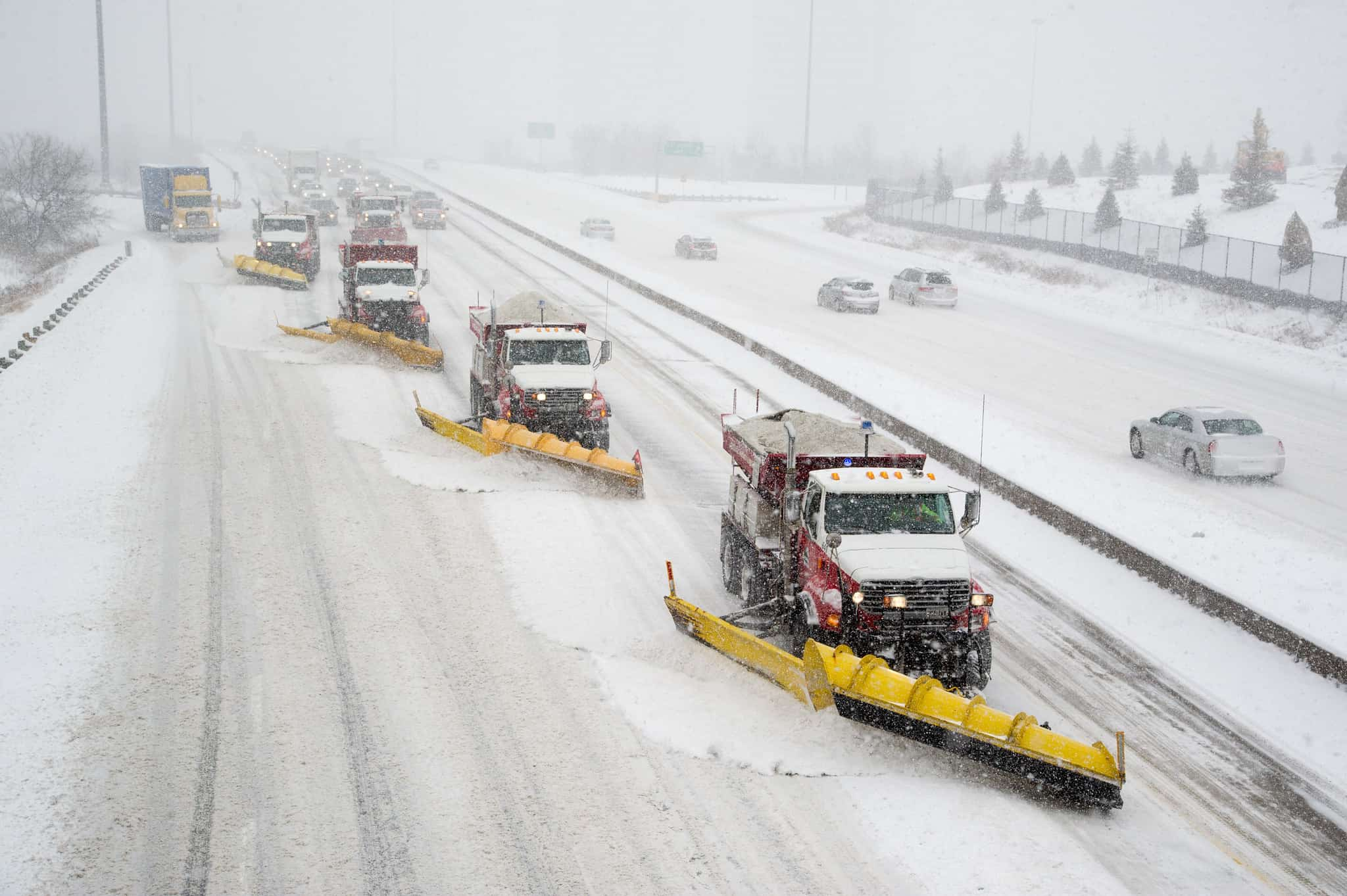 Snowplows on a Toronto freeway during winter